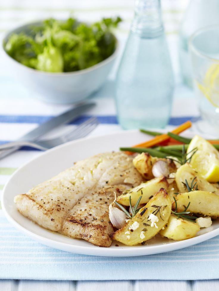 Pan-fried fish with garlic, rosemary & feta potato wedges.