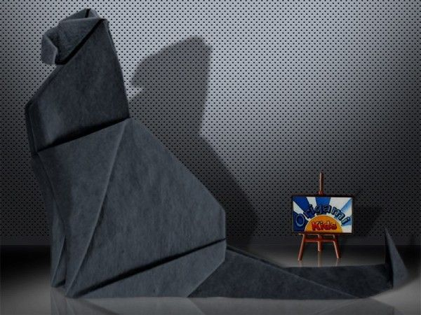 Sitting Cat by Daniela Carboni  Designer: Daniela Carboni  Folder and Photographer: @Origami_Kids  Complexity: Medium . Time to fold 30 min. 12 steps. Folded from a one classic Single Uncut square origami black paper, about 25 cm x 25 cm.  How to fold: http://origami-blog.origami-kids.com/sitting-cat-by-daniela-carboni.htm