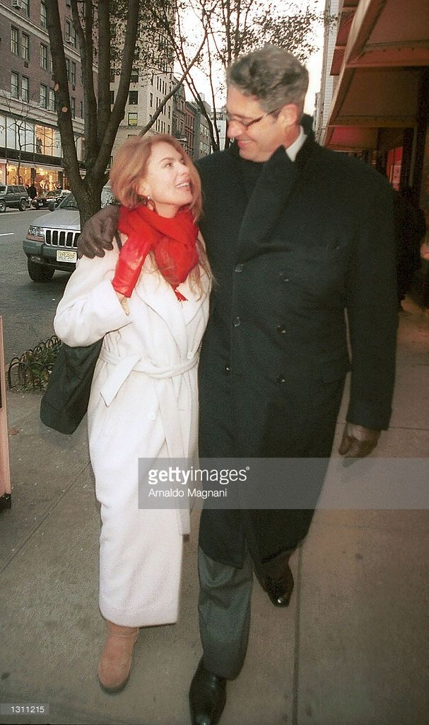 Actress Roma Downey and Michael Nouri walk on Madison Avenue, December 9, 2000 in New York City.