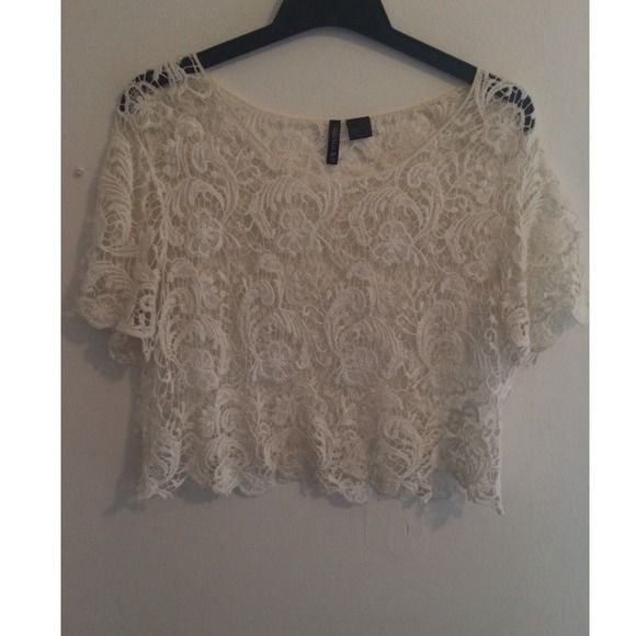 White Lace Crop Top Flowy white lace crop top from Cotton On. Great condition although has a few faded red spots, as shown in the picture, yet hardly noticeable Cotton On Tops Crop Tops