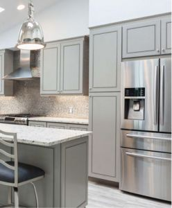 This kitchen features J&K Cabinets in Greige.  This is one of the hottest colors on the market right now.  We love these cabinets paired with the light countertops and backsplash. The light gray flooring and stainless steel appliances are the perfect accent to showcase these cabinets.   http://kitchenazcabinetschandler.com