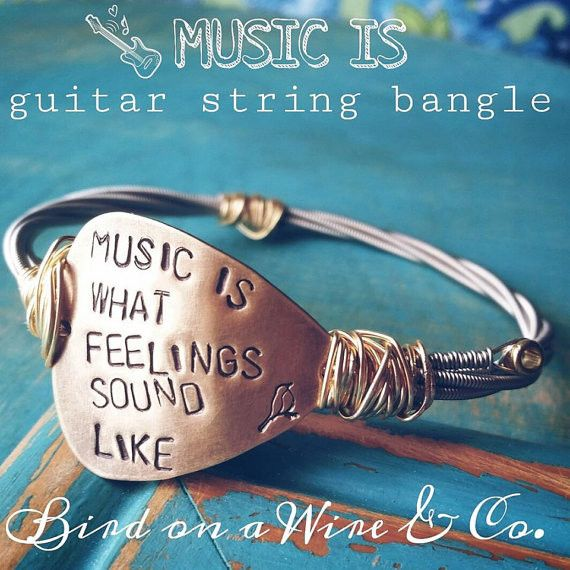 """""""MUSIC IS WHAT FEELINGS SOUND LIKE"""" guitar string bangle~ Handmade/handstamped bangle comes in sizes XS,S,M,L,XL just let us know what size you need. Here's an idea of how sizing works. XS- teeny wris"""