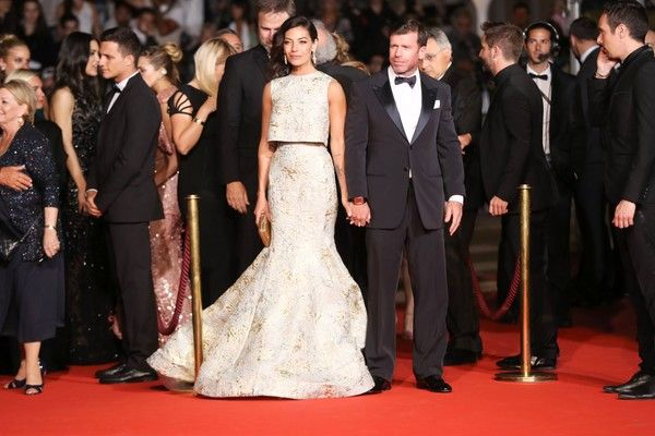 Nicole Sheridan Photos Photos - US director Taylor Sheridan (C-R) and his wife Nicole Sheridan arrive on May 20, 2017 for the screening of the film 'Wind River' at the 70th edition of the Cannes Film Festival in Cannes, southern France.  / AFP PHOTO / Valery HACHE - 'Wind River' Red Carpet Arrivals - The 70th Annual Cannes Film Festival