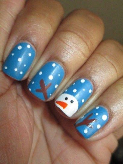 Nail art azzurra con pupazzo di neve per Natale 2014