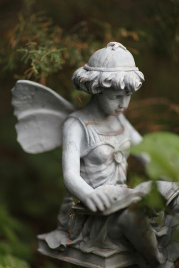33 best images about yard statues on pinterest lawn ornaments garden statues and cat statue - Reading fairy garden statue ...