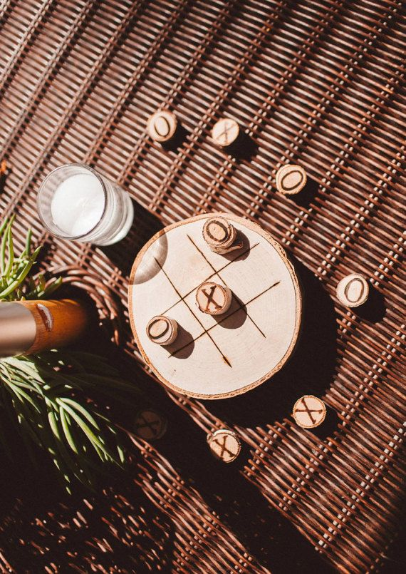 Rustic Tic Tac Toe Board Game.  A game that both children and adults enjoy. This game can be played indoors or outdoors.   Made of real wood pieces, this tic tac toe game has a truly rustic look! Perfect for family game night or entertaining guests during Cocktail hour at a rustic wedding or event.  **Picture taken by JC Guzman Wedding Photographer