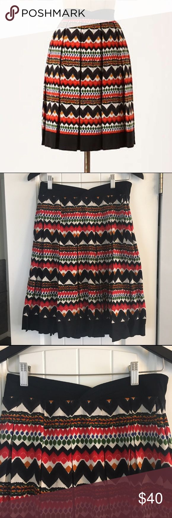Anthropologie Aztec Print Skirt Beautiful pleated skirt in a fun Aztec print from fei sold at Anthropologie, size 6. Excellent condition, zipper on the side. Anthropologie Skirts