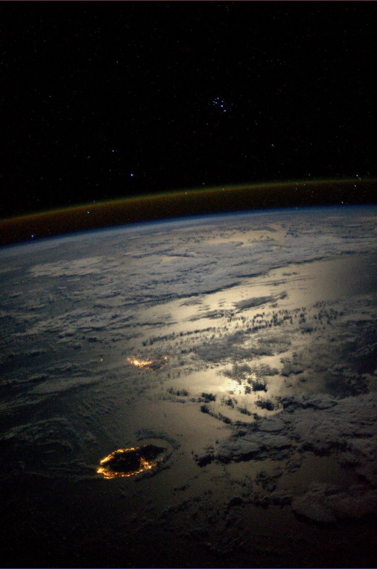 Seven Sisters overlooking Reunion and Mauritius Islands in a moonlit Indian Ocean. Taken August 25, 2013.  KN from space. #NASA #Discovery