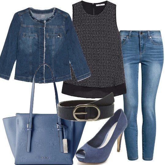 Jeans, modello skinny, a vita alta, li ho abbinati ad una camicia in viscosa, senza maniche, fantasia a stampa con elastico in vita e ad una giacca di jeans di media lunghezza. Ho scelto una décolleté in tessuto con tacco alto, una borsa in similpelle Calvin Klein con cerniera ed una cintura blu da abbinare.
