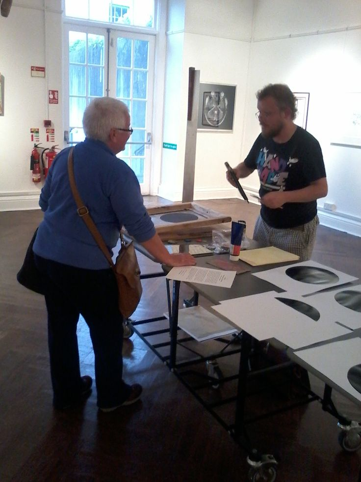 Artist Martin Fahy mid screen print demonstration
