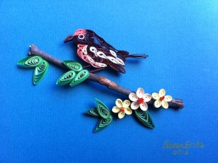 Little quilled bird sitting on a branch.