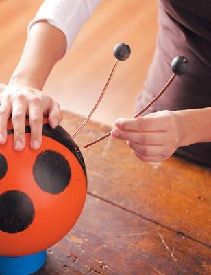 bowling ball lady bugs for your garden