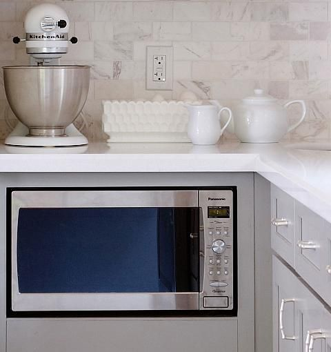 Tuck microwave under the counter in an out of the way, but easy-to-access spot. With room to spare, you can add a large drawer beneath the microwave.