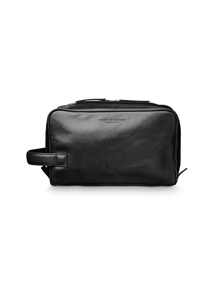 Tiger Other, Tigino toiletry bag-Men's sturdy toiletry bag in leather, with embossed logo at front. Two way zip with leather pull. Two inside pockets with elastic top edge. Side handle. Nylon lining. Size: 24 x 15 x 11 cm.