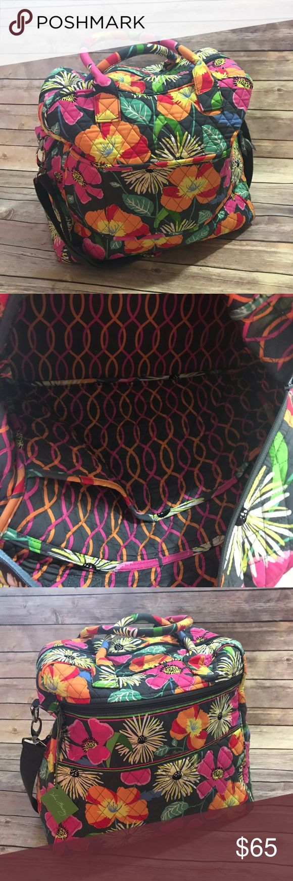 "Vera Bradley Overnight Travel Bag Jazzy Blooms Vera Bradley Overnight Travel Bag Jazzy Blooms  Great condition. Tag still attached and hard to tell but has been used lightly. Fabric handles and detachable shoulder strap with matching pad. Two slip pockets on the back and a slit so that it can be slipped over the handle of a rolling suitcase. Large zip pocket in front. Removable stiffener in the bottom. Two interior slip pockets. Very roomy. 14.5"" tall 16"" long 9"" wide Vera Bradley Bags…"