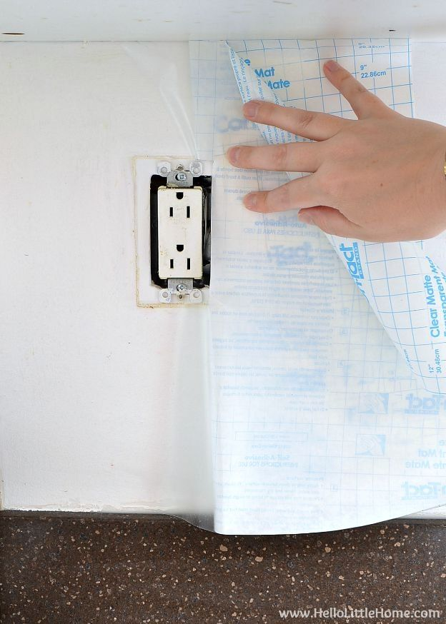 Apply clear contact paper under wall paper for easy removable.