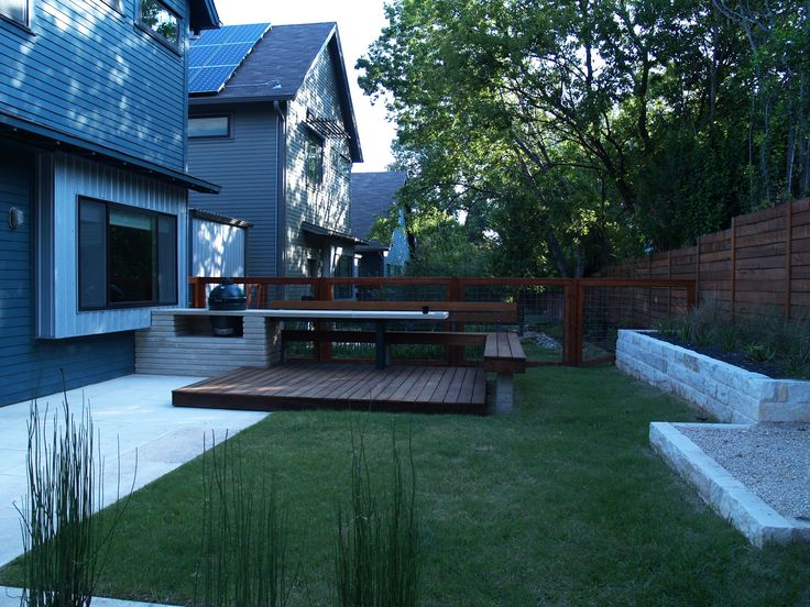 modern lueders limestone kitchen and ipe deck with integrated bench