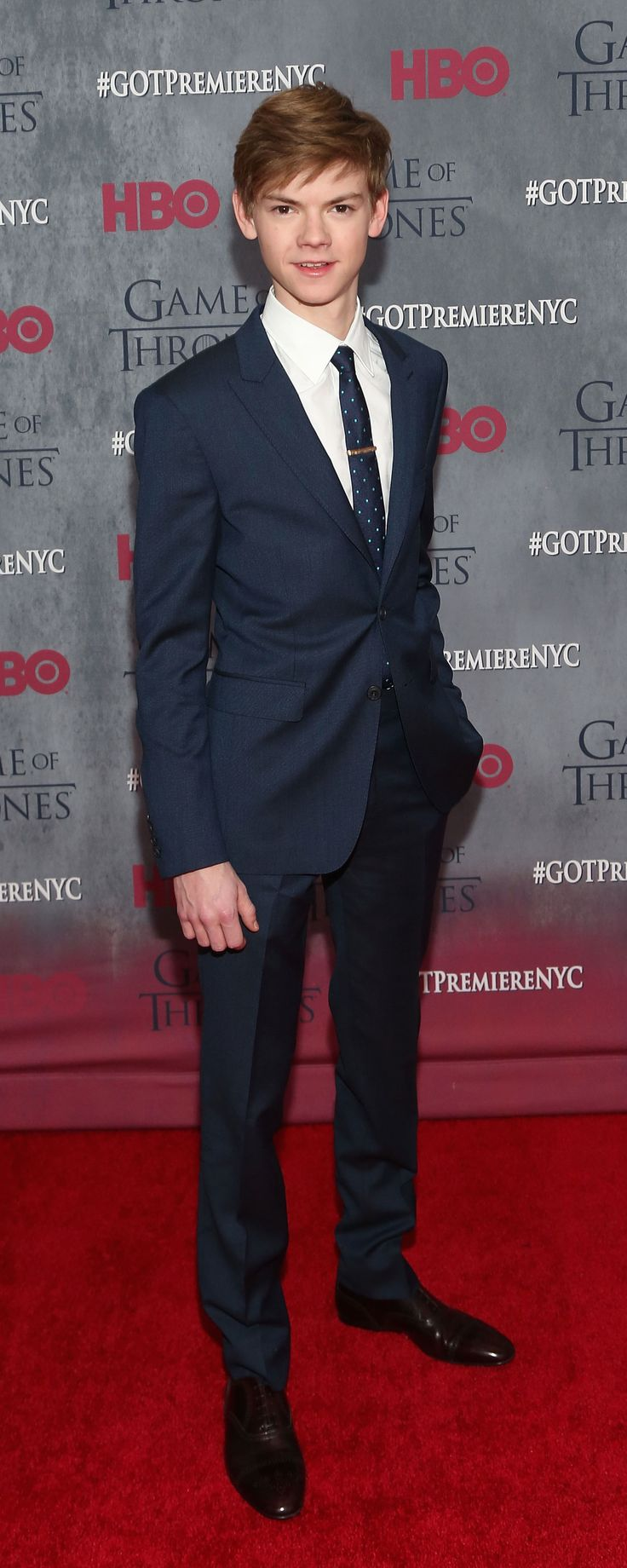 British actor Thomas Brodie-Sangster wearing Burberry tailoring to attend the Game of Thrones new season premiere in New York