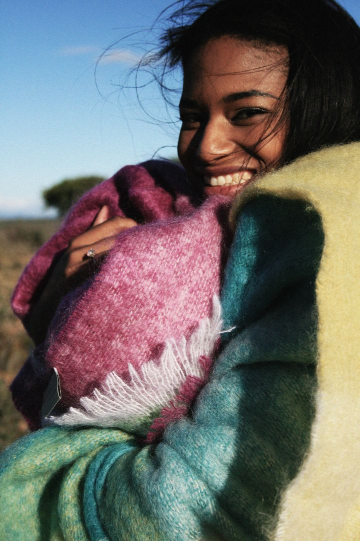 Miss South Africa snuggling up to a Hinterveld Mohair Blanket in the Karoo.