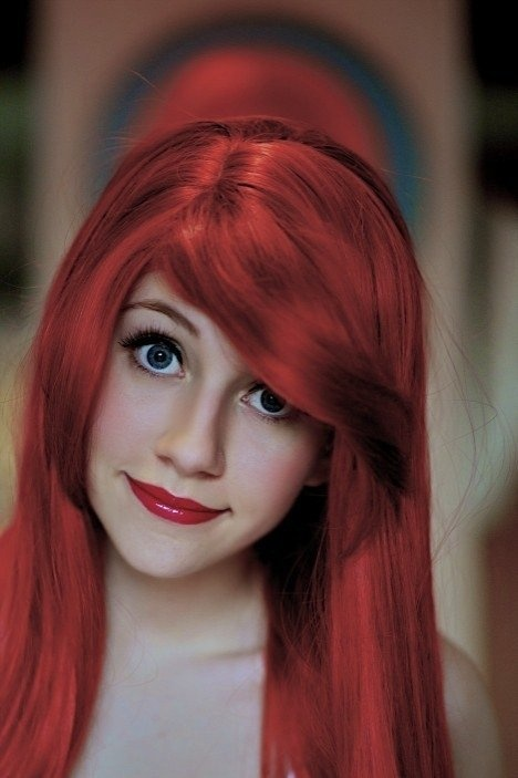 "This girl has got to be the most realistic Ariel ever! Her eyes and thin ""Ariel"" eyebrows, and smile are pefect."