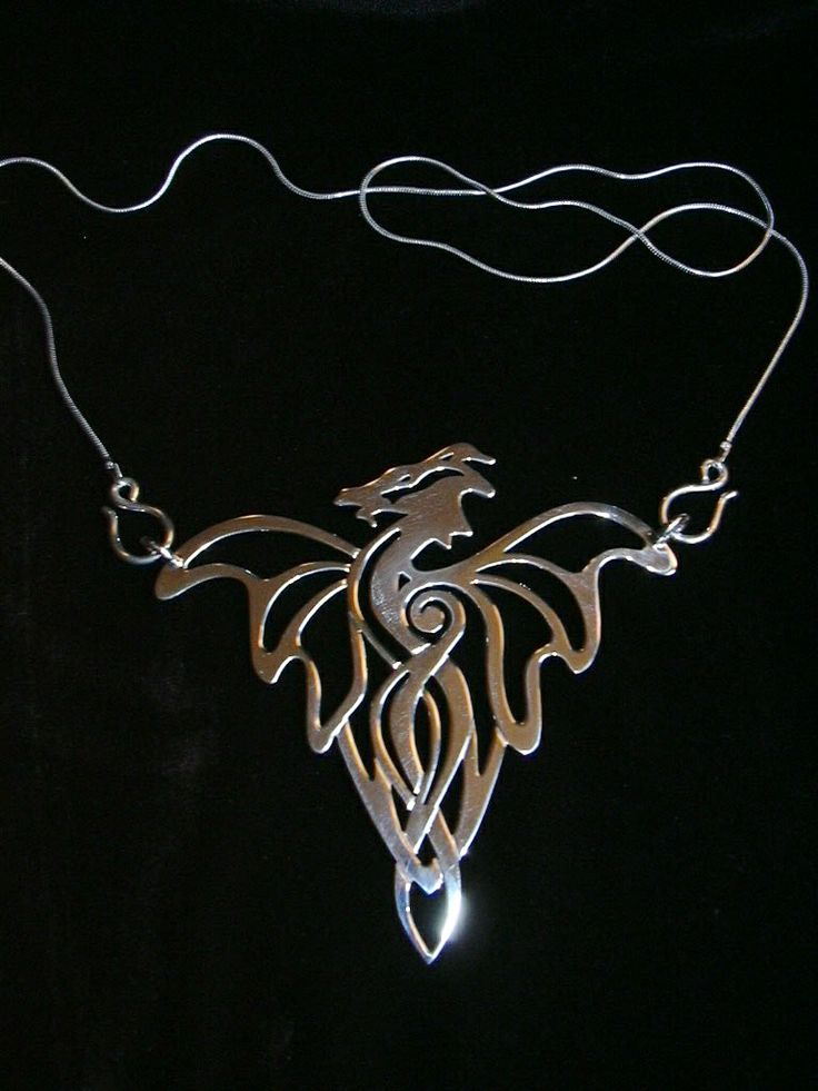 Handcrafted Celtic Dragon pendant by Chasing Destiny Silver