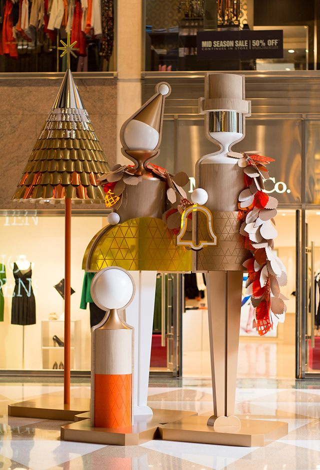 Sydney's iconic Chifley Plaza became a magical destination for Christmas shoppers with the addition of a whimsical wonderland of supersized wooden dolls.