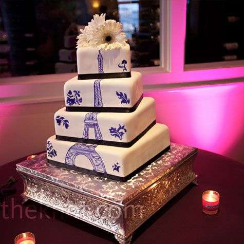 "A cake can be personalised to tell the story of one's love. First intimate trips of the couple can be captured and reminisced through this cake. ""The Eiffel Tower was hand-painted in a deep purple color on the four offset tiers of the cake."" -The Knot."