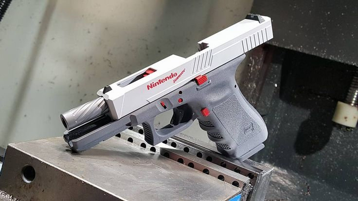 Weapons Lover - Glock made to look like Nintendo Zapper Remember... Find our speedloader now!  www.raeind.com  or  http://www.amazon.com/shops/raeind