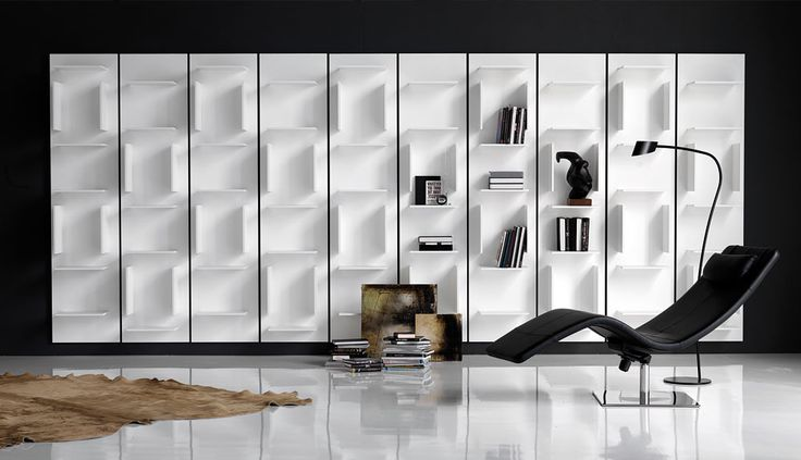 Love the shelving unit on the wall nd the simple yet modern lounge chair!