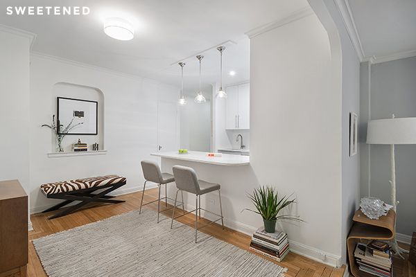 Upper West Side Kitchen features a durable Quartz surface countertop with an open-plan space - great for hosting guests!