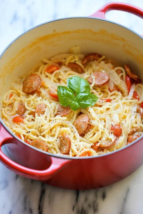 Andouille Sausage and Tomato Pasta | Few dishes are easier than pasta with andouille sausage and tomatoes.  All the ingredients are placed in a dutch oven, covered in water and left to cook. @damndelicious