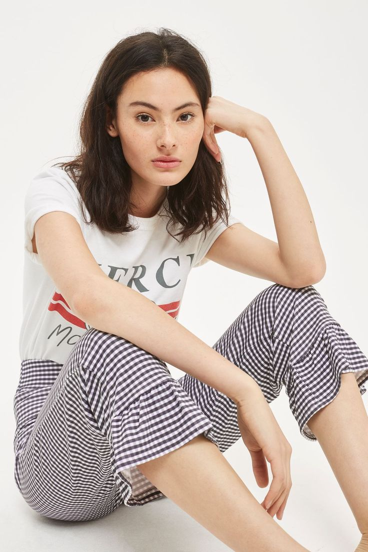 These fancy gingham trousers feature a cropped, high-waisted fit and a fun frill hem. Team with pared-down separates and a laid-back attitude.