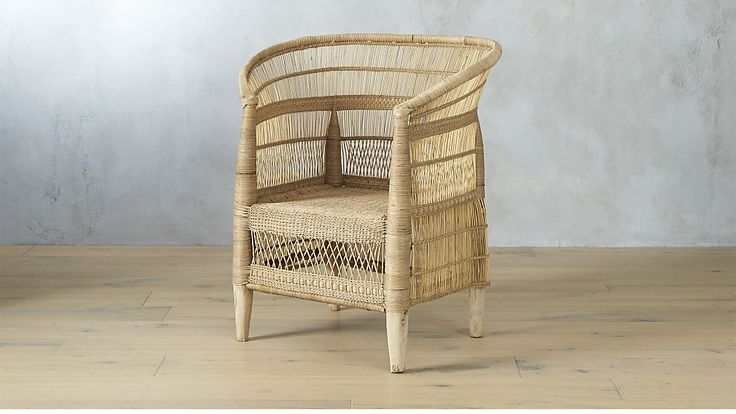""""""" Each chair takes 10 days to complete, handcrafted by Malawi artisans in collaboration with CB2 and non-profit organization People of the Sun"""" woven malawi chair"""