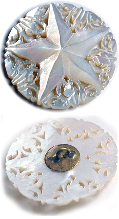 carved pearl button...star...