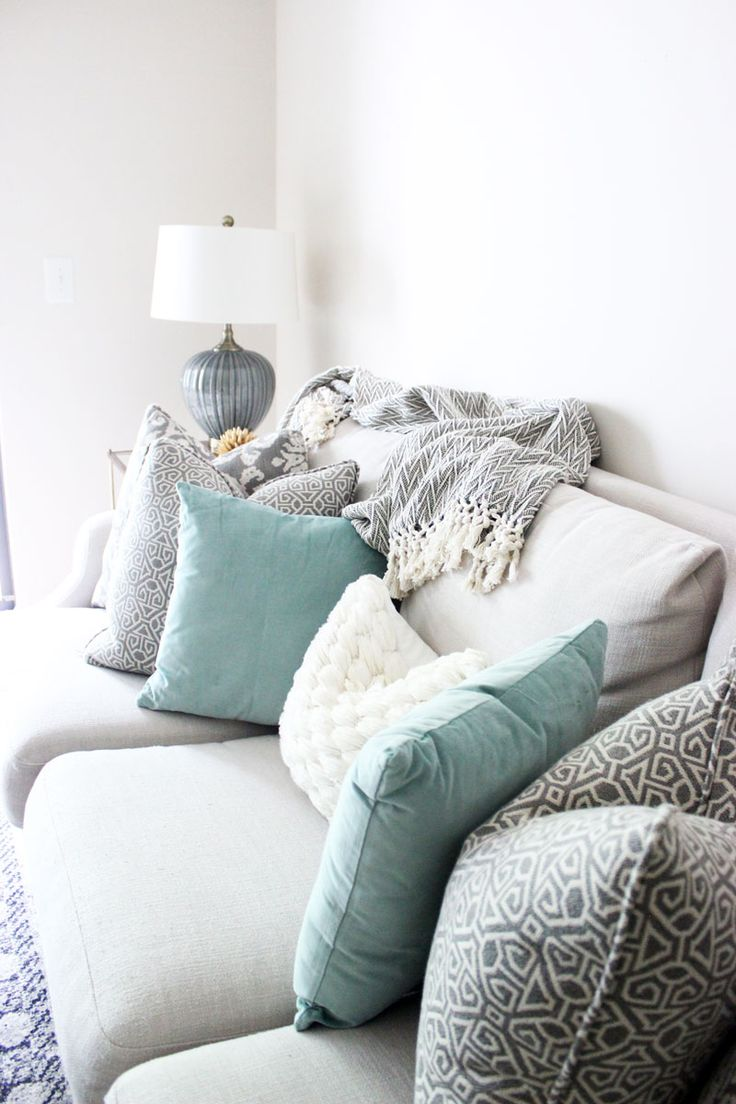 Bright White Living Room, Printed Pillows, Neutral Couch