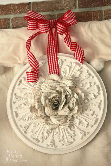 Paper rose made from old book pages    http://www.prettyhandygirl.com/2012/02/book-page-rose-wreath.html