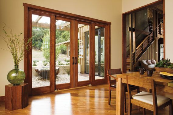 Bring some of the outdoors inside with large glass windows and glass sliding doors. #windows #doors