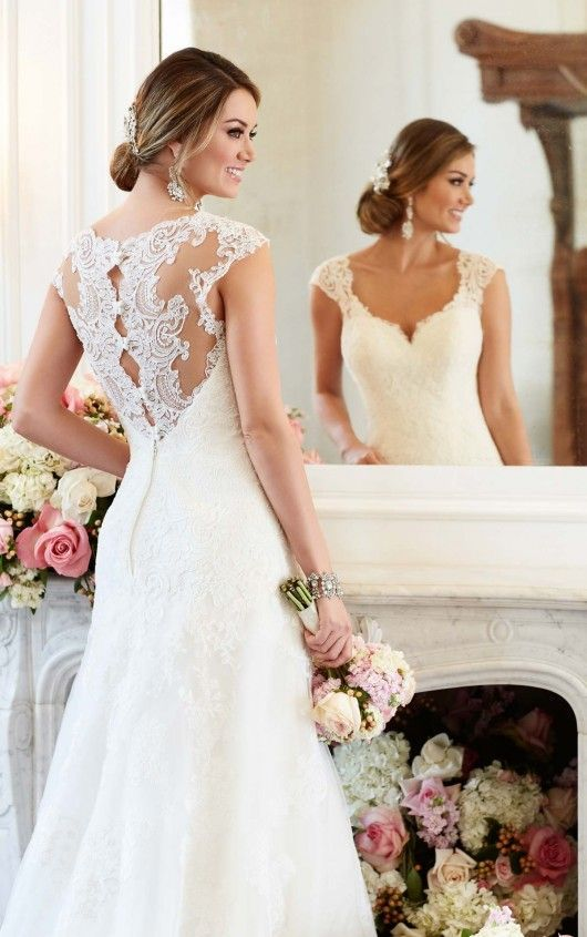 This romantic A-line wedding gown from Stella York boasts eye-catching lace cap sleeves and a scalloped-lace illusion back with pretty fabric-covered buttons. The sweetheart neckline frames the face and features a scalloped lace trim that coordinates with scalloped lace on the hem.