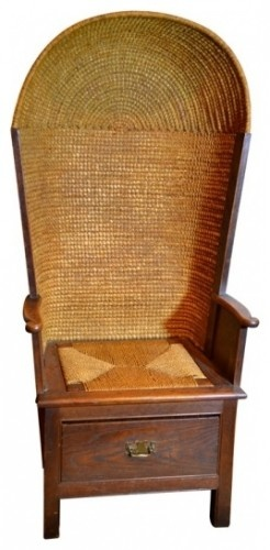 early 20th Century.  Made in virtually the same fashion for nearly 200 years, Orkney Island chairs feature distinctive, densley woven straw backs. This example is in a classic hooded shape. The wood is oak. This chair also has a custom cushion.