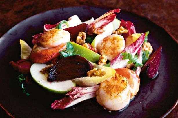 A warm, winter salad of pan-seared scallops and packed with crunchy apple, endive, rocket, beetroot and walnuts. The salad is dressed with a classic honey-Dijon mustard. Yum!