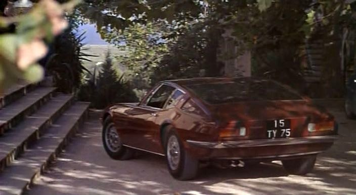 A Maserati Ghibli arrives at a hillside St. Tropez, from the french film La Piscine