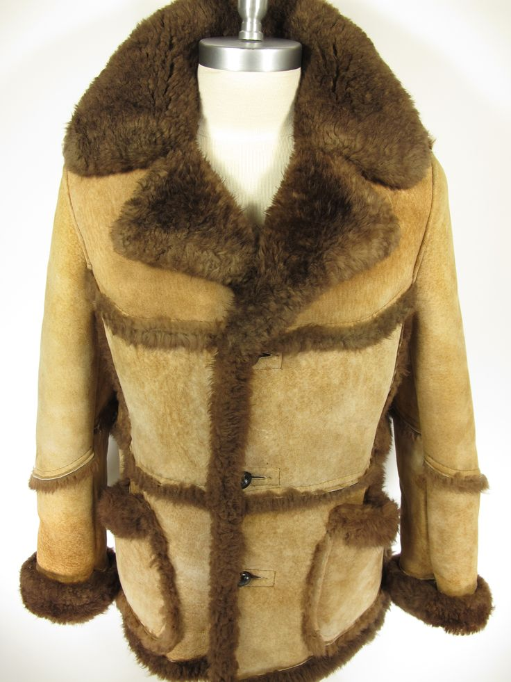 Vintage Silverwoods Shearling sheepskin jacket coat. Patch shearling accents reflect the marlboro style quite nicely. Find many like it at The Clothing Vault.