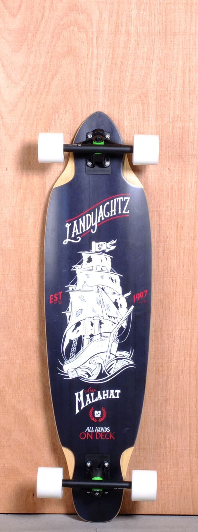 """The Landyachtz Malahat Longboard Deck is designed for Carving, Cruising and Freeride. Ships fully assembled and ready to skate! Function: Carving, Cruising, Freeride Features: Medium W Concave, Rocker, Wheel Wells Material: 5 Ply Vertically Laminated Bamboo, Fiberlass Core Length: 38"""" Width: 10"""" Wheelbase: 27.5"""" Thickness: 9/16"""" Hole Pattern: Old School Grip: Black"""
