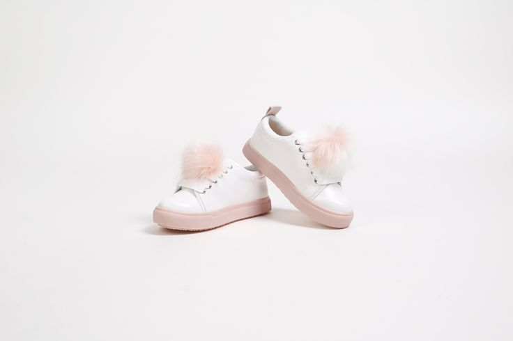 If she likes her after-school wardrobe to be stacked with fun, she'll fall head over heels for new Pomtastic. The latest lace-up sneaker to emerge from Mini Miss KG's collection, set in white with a two-tone pom pom gracing the vamp.