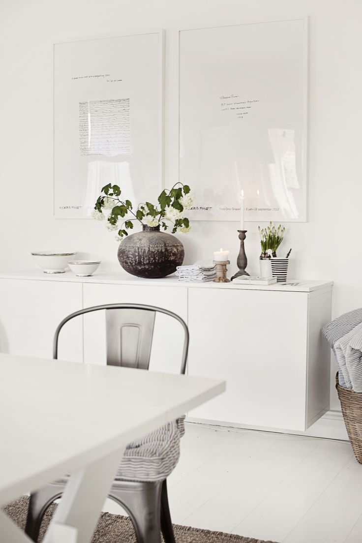 Floating white credenza; bright white interior; modern styling.