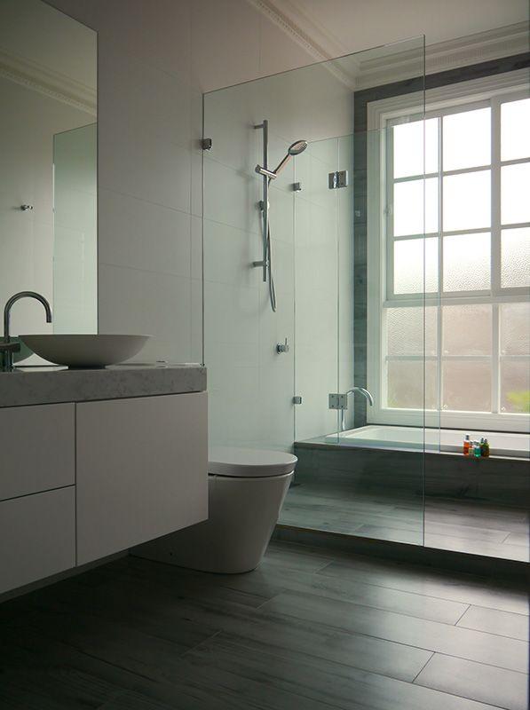 eat.bathe.live :: bathroom designed by eat.bathe.live featuring timber look tiles and sunken bath