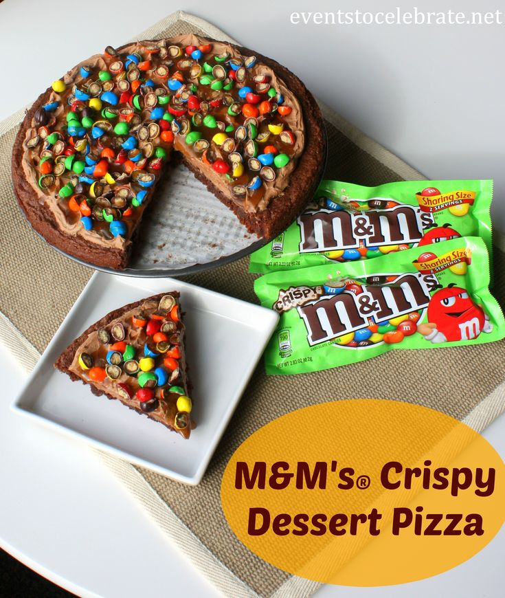 M&M'S Crispy Dessert Pizza - a soft chewy brownie, fluffy buttercream and silky caramel sauce topped with the perfect crunch of M&M'S Crispy!