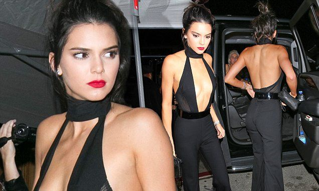 Kendall Jenner shows chest and taut torso in plunging jumpsuit