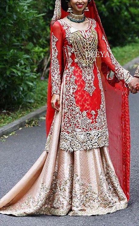 Pakistani punjabi bride wearing punjabi lacha-lehenga and kameez. Multani mala.