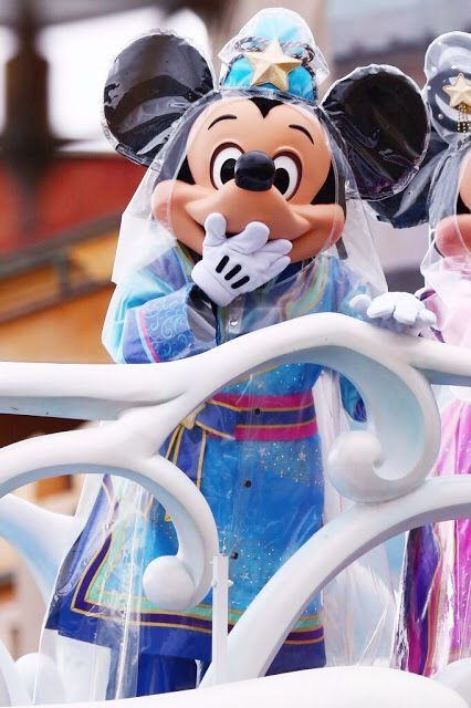 Mickey performing a show in the rain at Tokyo Disney Sea.